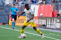 FOXBOROUGH, MA - MAY 16: Waylon Francis #14 Columbus SC passes the ball near the New England Revolution goal during a game between Columbus SC and New England Revolution at Gillette Stadium on May 16, 2021 in Foxborough, Massachusetts.