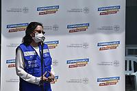 BOGOTA - COLOMBIA, 18-02-2021: Gina Tambini, Representante de OPS/OMS Colombia, durante la primera jornada de vacunación contra el COVID-19 (Coronavirus) que se llevo a cabo en la clínica Colombia en la ciudad de Bogotá. Son las primeras 50.000 vacunas de la farmacéutica Pfizer y que representan un 0.08% de las requeridas en Colombia fueron distribuidas en diferentes ciudades del país para comienzan su aplicación en personal de la salud que son los más expuestos al contagio del Coronavirus. / Gina Tambini, Representative of PAHO / WHO Colombia, during the first  day of vaccination against COVID-19 (Coronavirus) that took place at the Colombia clinic in the city of Bogotá. They are the first 50,000 vaccines from the pharmaceutical company Pfizer that represent 0.08% of those required in Colombia and were distributed in different cities of the country to begin their application in health personnel who are the most exposed to the contagion of the Coronavirus. Photo: VizzorImage / Alejandro Avandaño / Cont