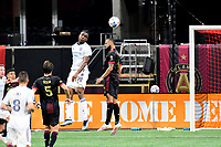 ATLANTA, GA - APRIL 24: Atlanta United defender #4 Anton Walkes clears a header from Chicago forward #9 Chinonso Offor during a game between Chicago Fire FC and Atlanta United FC at Mercedes-Benz Stadium on April 24, 2021 in Atlanta, Georgia.