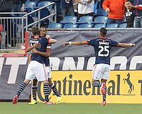 New England Revolution substitute forward Jerry Bengtson (27) celebrates his goal with teammates.  In a Major League Soccer (MLS) match, the New England Revolution (blue/white) defeated Houston Dynamo (orange), 2-0, at Gillette Stadium on April 12, 2014.