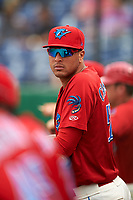 Clearwater Threshers relief pitcher Ranfi Casimiro (52) in the dugout during a game against the Palm Beach Cardinals on April 15, 2017 at Spectrum Field in Clearwater, Florida.  Clearwater defeated Palm Beach 2-1.  (Mike Janes/Four Seam Images)