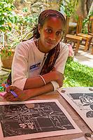 Artist Muhsana Ali with Work of Husband Amadou Kane Sy at Biannual Arts Festival, Goree Island, Senegal.