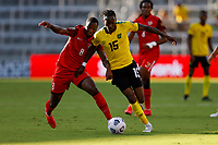 July 16th 2021; Orlando, Florida, USA;  Malpon (Gua) and Jamaica forward Blair Turgott grapple for the ball during the Concacaf Gold Cup match between Guadeloupe and Jamaica on July 16, 2021 at Exploria Stadium in Orlando, Fl.