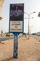 """Senegal, Touba.  Sign Prohibiting Tobacco in Touba.  (""""No to tobacco.  Holy Touba, city without tobacco."""")  Alcohol is also forbidden within city limits.  Street Scene."""