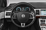 Car pictures of steering wheel view of a 2015 Jaguar XF 2.2D 163 auto 4 Door Sedan 2WD Steering Wheel