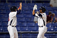 Binghamton Rumble Ponies second baseman L.J. Mazzilli is congratulated by a teammate after hitting a home run in the bottom of the seventh inning during a game against the Altoona Curve on May 17, 2017 at NYSEG Stadium in Binghamton, New York.  Altoona defeated Binghamton 8-6.  (Mike Janes/Four Seam Images)