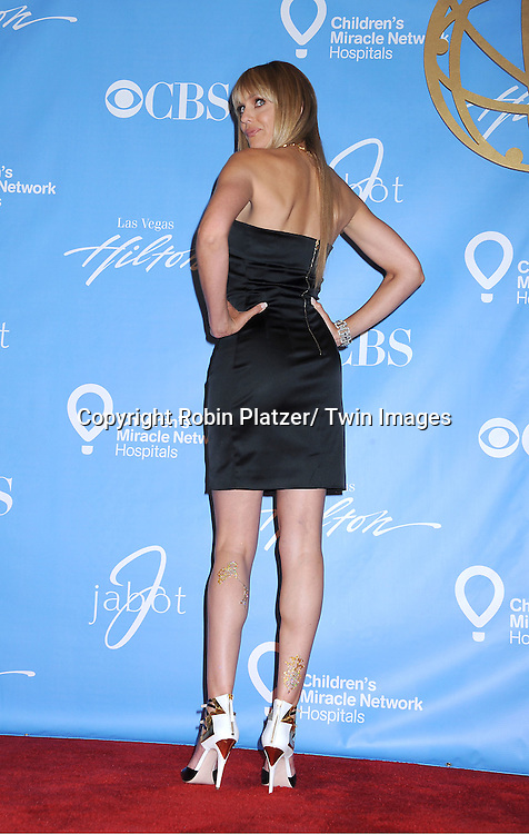Arianne Zucker posing in the press room at the 38th Annual Daytime Emmy Awards  on June 19, 2011 at The Las Vegas Hilton in Las Vegas Nevada. ..