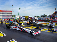 May 4, 2018; Commerce, GA, USA; NHRA top fuel driver Steve Torrence (near) races alongside Tony Schumacher during qualifying for the Southern Nationals at Atlanta Dragway. Mandatory Credit: Mark J. Rebilas-USA TODAY Sports