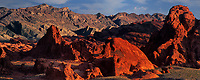 971000004 panoramic view -  low angled sunset light highlights the sandstone formations and red rock mountains giving a three dimensional effect to the scene in valley of fire state park nevada