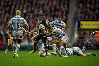 Ugo Monye of Harlequins is wrapped up in midfield during the Aviva Premiership match between Harlequins and London Irish at Twickenham on Saturday 29th December 2012 (Photo by Rob Munro).