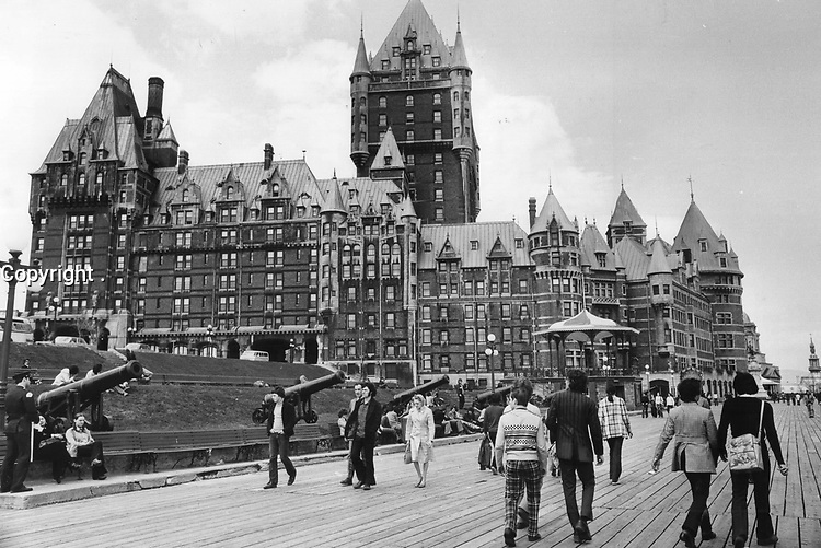 Chateau Frontenac looms above Dufferin Terrace like a leftover from medieval times and seems to add just the right flavor to a walking tour of Quebec city. Actually; the hotel was built late in the 19th century.<br /> <br /> 1973<br /> <br /> PHOTO :  Doug Griffin - Toronto Star Archives - AQP