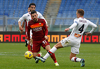 Roma's Carles Perez, left, is fouled by Genoa's Domenico Criscito during the Italian Serie A Football match between Roma and Genoa at Rome's Olympic stadium, March 7, 2021.<br /> UPDATE IMAGES PRESS/Riccardo De Luca