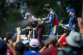 Will Power, Team Penske Chevrolet, Felix Rosenqvist, Chip Ganassi Racing Honda, Alexander Rossi, Andretti Autosport Honda celebrate on the podium with champagne