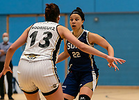 Catherine Carr of Sevenoaks Suns looking for the pass during the WBBL Championship match between Sevenoaks Suns and Newcastle Eagles at Surrey Sports Park, Guildford, England on 20 March 2021. Photo by Liam McAvoy