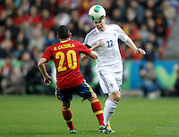 Spain's Santi Cazorla (l) and Finland's Raitala during international match of the qualifiers for the FIFA World Cup Brazil 2014.March 22,2013.(ALTERPHOTOS/Acero)