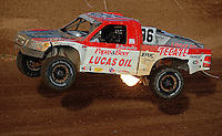 Apr 17, 2010; Surprise, AZ USA; LOORRS pro 2 unlimited driver Rodrigo Ampudia takes a jump during round 3 at Speedworld Off Road Park. Mandatory Credit: Mark J. Rebilas-US PRESSWIRE.