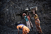 Young children and other residents dig out coal from the open cast mines in Borapahari in Jharia, Jharkhand, India.  Photo: Sanjit Das