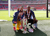 29th May 2021; Wembley Stadium, London, England; English Football League Championship Football, Playoff Final, Brentford FC versus Swansea City; Goalkeeper David Raya and Ivan Toney of Brentford celebrate with the Sky Bet EFL Championship Plays-off Trophy and their 2-0 win and promotion to the Premier League