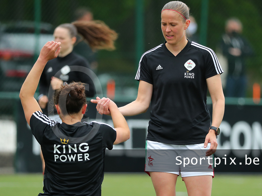 Lenie Onzia (8) of OHL gives a hand to Sara Yuceil (13) of OHL during her stretching before a female soccer game between Oud Heverlee Leuven and AA Gent Ladies on the 9 th matchday of play off 1 in the 2020 - 2021 season of Belgian Womens Super League , saturday 22 nd of May 2021  in Heverlee , Belgium . PHOTO SPORTPIX.BE   SPP   SEVIL OKTEM