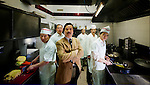 strange fruits is a work about immigration problems in Italy. Like the song of Billie Holyday wants to focus on problems derived from mixing different cultures. In this picture Yi Guisen  portraited with his staff in the kitchen of his restaurant in Sassari