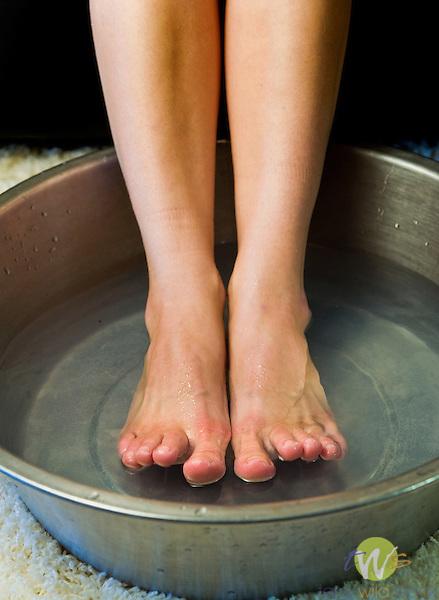 Female soaking feet.