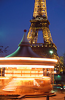 France Paris The Eiffel tower and merry go round in the Trocadero garden at dusk