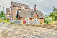 BNPS.co.uk (01202 558833)<br /> Pic: PropertyPublicity/BNPS<br /> <br /> Pictured: The house was built in 1850<br /> <br /> Loco-cation, loco-cation, loco-cation..<br /> <br /> This quirky property that is up for sale is all about its loco-cation - as it sits on a railway crossing right next to the train tracks.<br /> <br /> The Grade II listed cottage was built in 1850 to house the gatekeeper whose job it was to close the gates at the road crossing whenever a train was due.<br /> <br /> The gates, in the village of Stone, Staffs, were automated many years ago.