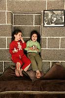 Two girls against the black basalt stonework typical of Diyarbakir, southeastern Turkey