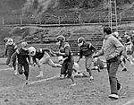 Bethel Park PA:  Bethel Recreation Football League's Chamber of Commerce Football team.  We played all the games at the Senior High Football Field. Team members include; John Rassmussen, Mike Stewart, Scott Streiner, Fred Griffin, Rick Matthews, Joe Fredley, Bruce Mahoney, Coaches Frank Feeney, and Jim Mahoney.  Mr. Chris, Director of the Recreation League was also the referee; he is in the foreground.