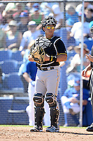 Catcher Tony Sanchez (26) of the Pittsburgh Pirates during a spring training game against the Toronto Blue Jays on February 28, 2014 at Florida Auto Exchange Stadium in Dunedin, Florida.  Toronto defeated Pittsburgh 4-2.  (Mike Janes/Four Seam Images)
