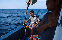 TUNISIA island Kerkennah, sponge diver, fishing boat Monastir II, captain Hassan Ben Belgassen, sponge is a sea animal, diver collect the spong from sea ground in 20 Meter depth, after washing and cleaning the skeleton is sold as bath sponge / TUNESIEN Insel Kerkenna, Schwammtaucher Monastir II im Mittelmeer, der Schwamm ist ein Meerestier, Taucher holen den Schwamm vom Meeresboden aus ca. 20 Meter Tiefe, nach Auswaschen der Zellen erscheint das Skelett, das als Badeschwamm vermarket wird