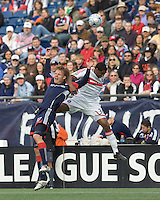 New England Revolution forward Edgaras Jankauskas (10) and Chicago Fire defender Dasan Robinson (32) battle for head ball. The New England Revolution out scored the Chicago Fire, 2-1, in Game 1 of the Eastern Conference Semifinal Series at Gillette Stadium on November 1, 2009.