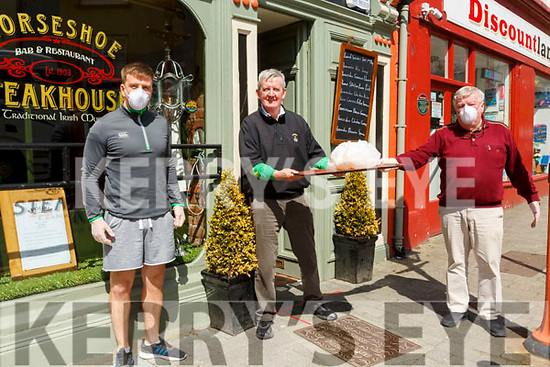 Horsehoe Restaurant Take Away: David Fitzmaurice, centre getting his take away lunch from Diarmuid & Gerry Behan of Behan's Horse Restaurant, Listowel who are offering a take away service during this pandemic crisis.