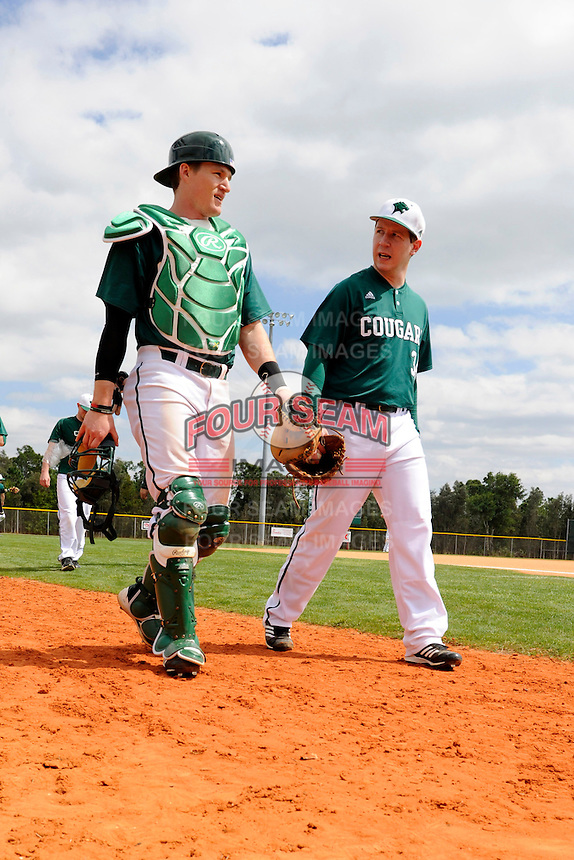 Chicago State University Cougars pitcher James Tucker #34 and catcher Eric O'Brien #10 walk to the dugout before a game against the Muskingum Fighting Muskies at South County Regional Park on March 3, 2013 in Punta Gorda, Florida.  (Mike Janes/Four Seam Images)
