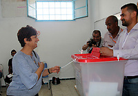 Mohamed abou wife, a candidate for Tunisia's presidential elections, smiles after casting his ballot at a polling station in the capital Tunis on September 15, 2019. - Rarely has the outcome of an election been so uncertain in Tunisia, the cradle and partial success story of the Arab Spring, as some seven million voters head to the polls today to choose from a crowded field.<br /> <br /> PHOTO : Agence Quebec Presse -  JDIDI_WASSIM