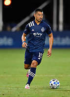 LAKE BUENA VISTA, FL - JULY 26: Roger Espinoza of Sporting KC looks for options with ball during a game between Vancouver Whitecaps and Sporting Kansas City at ESPN Wide World of Sports on July 26, 2020 in Lake Buena Vista, Florida.