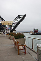 Benches behind a business complex with the raised Lefty O'Doul drawbridge at 3rd Street next to AT&T Park.