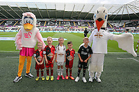 Pictured: Children mascots with Cyril and Cybil the swans. Saturday 23 August 2014<br /> Re: Premier League, Swansea City FC v Burnley at the Liberty Stadium, south Wales