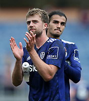 29th August 2021; Turf Moor, Burnley, Lancashire, England; Premier League football, Burnley versus Leeds United: Patrick Bamford of Leeds United returns the applause from the visiting supporters after the final whistle