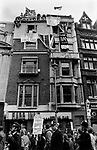Anti Falkland war demo Whitehall London May 1983 with counter demonstration, people hanging banners from building who are Pro Falkland war. Banners read CND Communists Neutralists Defeatists, Patriotism not Treason 1980s