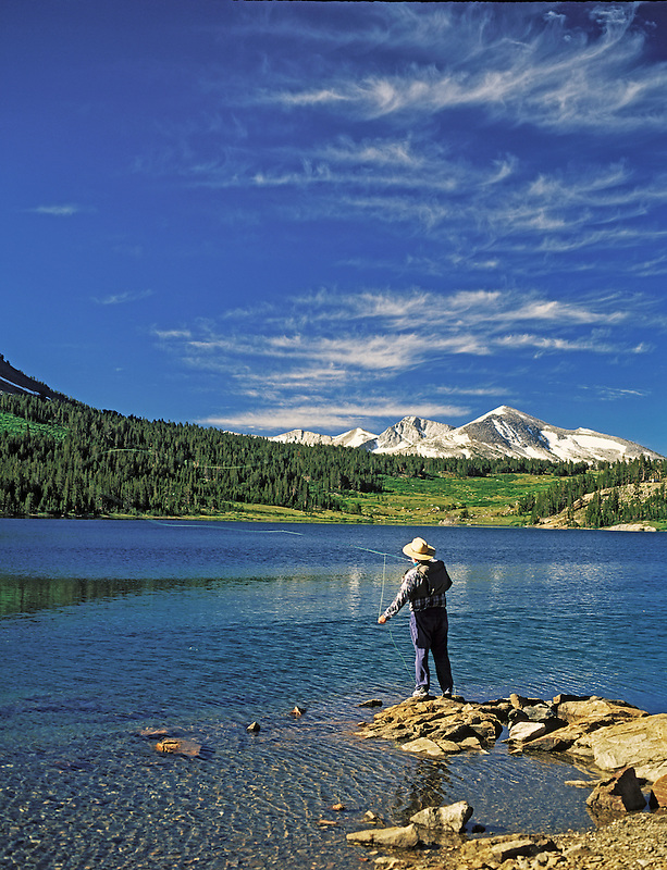 H00127M.tiff   Fly fisherman on Ellery Lake. Eastern Sierra Mountains. California