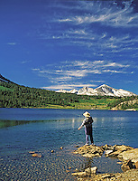 H00127M.tiff   Fly fisherman on Ellery Lake. Eastern Sierra Mountains. California