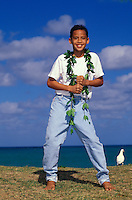 Boy dances auana (modern) hula with maile lei on