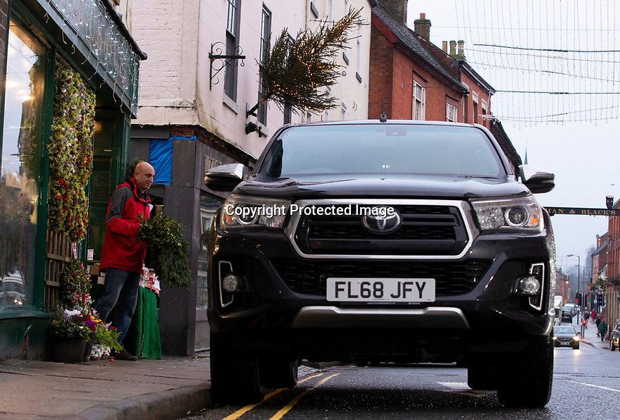 21/12/19<br /> <br /> Bob Dayal, known locally as 'Bob the Veg', loads his Toyota Hilux with customers' festive deliveries outside his greengrocers, Fresh Choice, in Ashbourne Derbyshire.<br /> <br /> All Rights Reserved: F Stop Press Ltd.  <br /> +44 (0)7765 242650 www.fstoppress.com