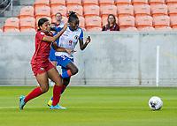 HOUSTON, TX - FEBRUARY 3: Hilary Jaen #4 of Panama and Sherly Jeudy #9 of Haiti go for the ball during a game between Panama and Haiti at BBVA Stadium on February 3, 2020 in Houston, Texas.