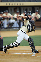 Wake Forest Demon Deacons catcher Logan Harvey (15) makes a throw to second base against the Miami Hurricanes at David F. Couch Ballpark on May 11, 2019 in  Winston-Salem, North Carolina. The Hurricanes defeated the Demon Deacons 8-4. (Brian Westerholt/Four Seam Images)