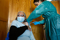 LISBON, PORTUGAL - MARCH 9: A person its seen receiving her dose of COVID-19 vaccine in Lisbon, on March 9, 2021.<br /> According to the latest data from the Directorate-General for Health, Portugal currently has over a million  people vaccinated.<br /> (Photo by Luis Boza/VIEWpress via Getty Images)