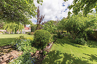 BNPS.co.uk (01202) 558833. <br /> Pic: SandersonYoung/BNPS<br /> <br /> Large garden.<br /> <br /> A quirky 'show home' for a brickwork owner where Lewis Carroll is believed to have stayed while writing some of his Alice in Wonderland books is on the market for just under £1m.<br /> <br /> Red Cottage is a striking Grade II listed property in Whitburn, Tyne and Wear, where Charles Dodgson, otherwise known as Lewis Carroll, regularly visited family.<br /> <br /> The unusual 179-year-old home was built to show off as many design features as possible, and has a walled garden and even an air raid shelter.