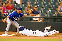 Las Vegas 51s third baseman Chris Woodward #5 catches a throw too late to catch Luis Hernandez #9 sliding in for a triple during the Pacific Coast League baseball game against the Round Rock Express on August 7th, 2012 at the Dell Diamond in Round Rock, Texas. The Express defeated the 51s 5-4. (Andrew Woolley/Four Seam Images).