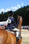 Young girl waiting to enter her class at the horse show at Cheshire Fair in Swanzey, New Hampshire USA